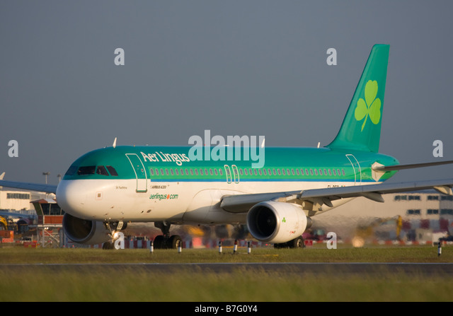 Aer Lingus Airbus A320-214 taxiing for departure at London Heathrow airport. - Stock Image