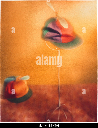 Polaroid transfer of Helicopter propeller hat on hat display. - Stock Image