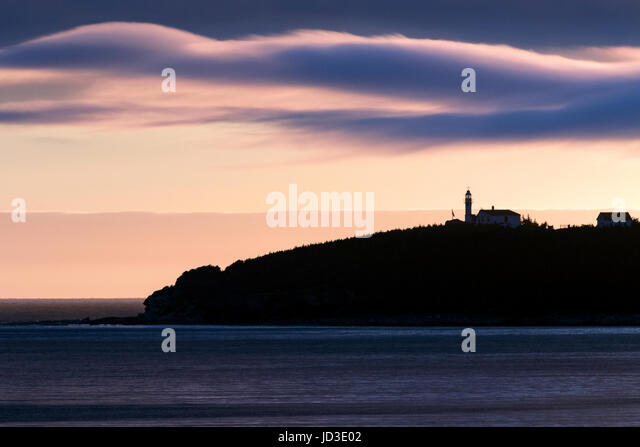 Sunset at Lobster Cove Head Lighthouse - Gros Morne National Park, Rocky Harbour, Newfoundland, Canada - Stock Image