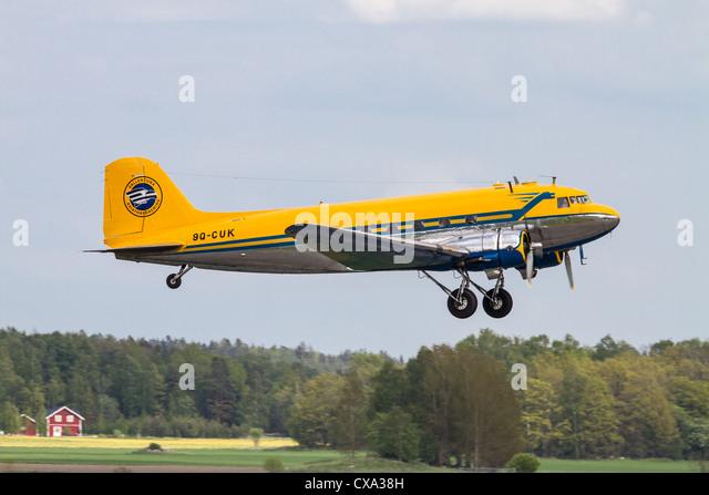 DC-3 vintage airliner taking off - Stock Image
