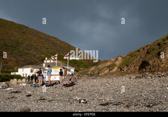 RNLI Lifeguards on the beach at Crackington Haven - Stock Image