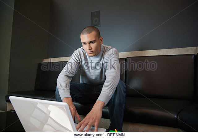 Businessman working on laptop - Stock-Bilder