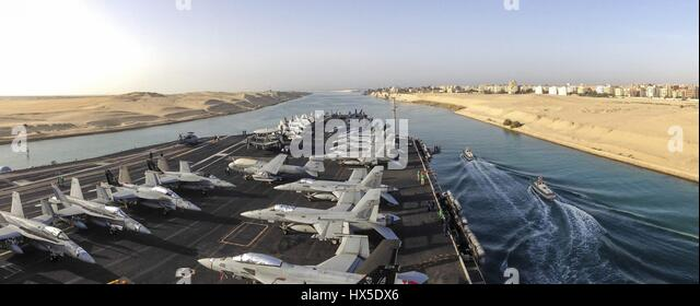 The aircraft carrier USS Dwight D. Eisenhower (CVN 69) transits the Suez Canal, 2013. Image courtesy Kameren Guy - Stock Image