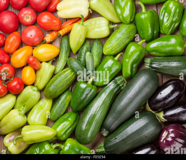 Fresh farmers garden vegetables on wooden table. Top view - Stock-Bilder