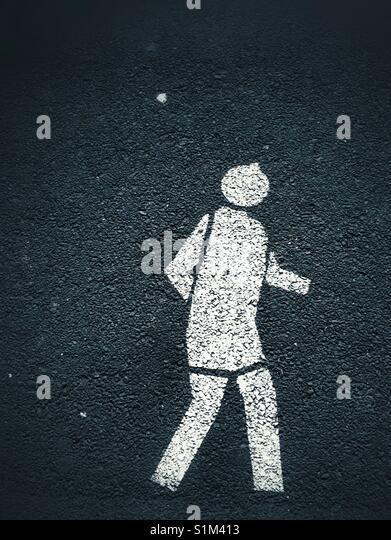 pedestrian walking road marking - Stock Image