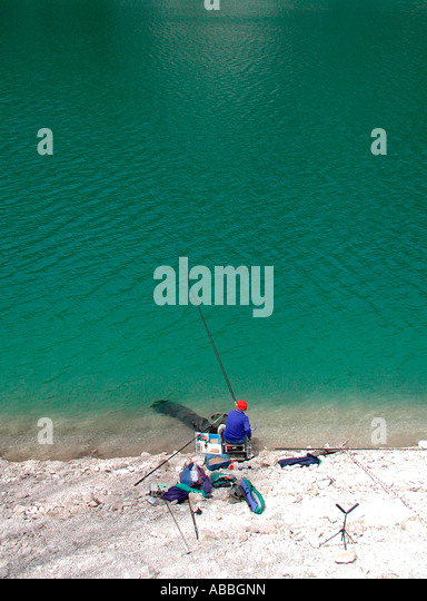 Fishing the beautiful Fiastra Lake in Le Marche Italy - Stock Image