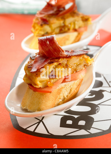 Spanish ham and potato omelette open sandwich - Stock Image