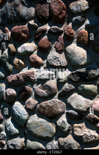 Stones set in concrete - Stock-Bilder
