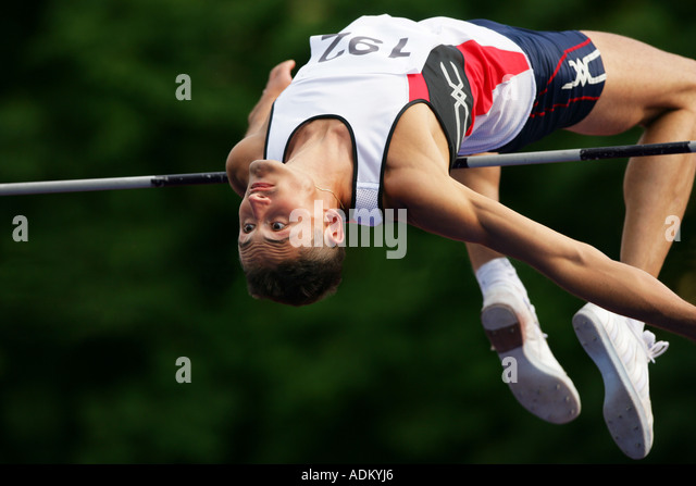 Male High Jumper Clearing the Bar - Stock-Bilder