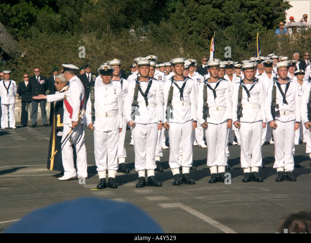 The Hon Judge John Alcantara CBE the Mayor of Gibraltar and First Sea Lord Admiral Sir Alan West inspecting sailors - Stock Image