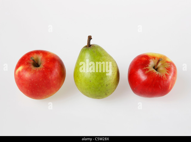 Apples and pear, elevated view - Stock Image