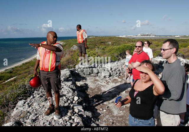 Grand Turk Atlantic Ocean Hawknest Plantation Gun Hill dune buggy excursion tour Black male guide - Stock Image