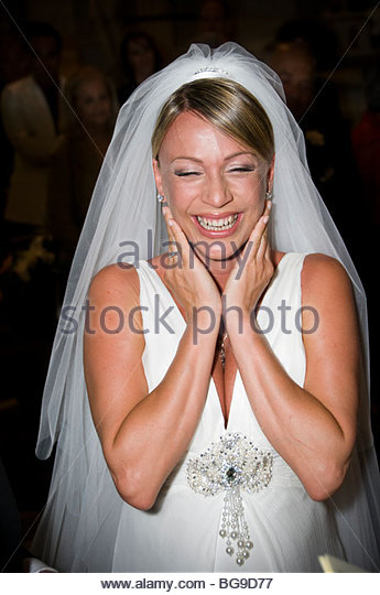 Young bride overcome with happiness - Stock Image