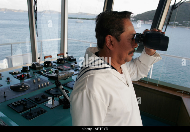 BVI Tortola Holland America Caribbean cruise ms Noordam Asian male officer binoculars - Stock Image