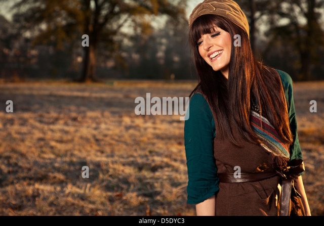 Woman laughing in field early morning - Stock Image
