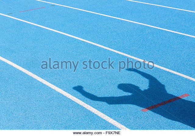 Tartan track and shadow of cheering athlete - Stock-Bilder