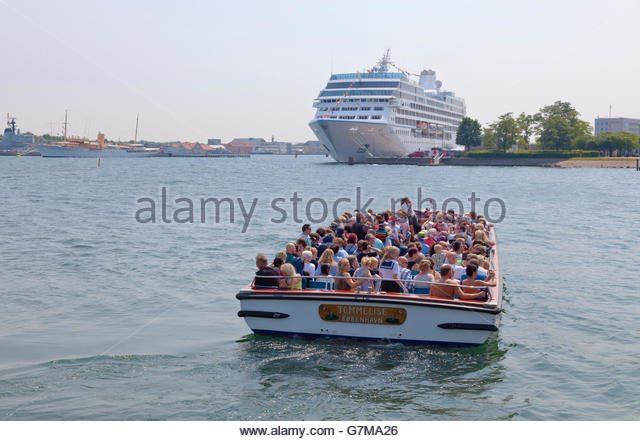 The canal cruise boat Tommelise and cruise ship MS Nautica moored at Nordre Toldbod in  Copenhagen Harbour. - Stock Image