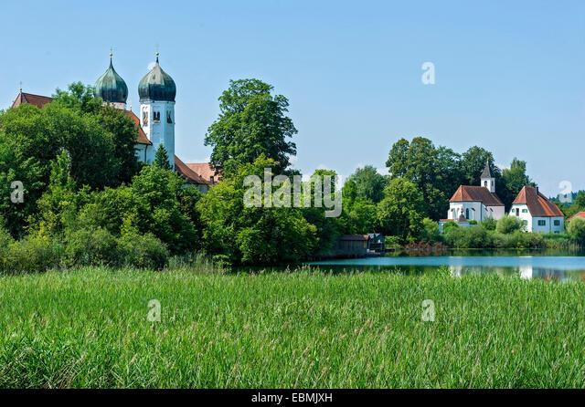 Benedictine monastery Seeon monastery with church of St. Lambert and Walburgiskapelle chapel, Klostersee, Seebruck, - Stock Image