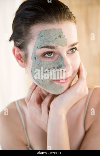Woman with cosmetic mask - Stock Image