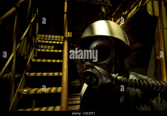 Ominous gas masked individual - Stock Image