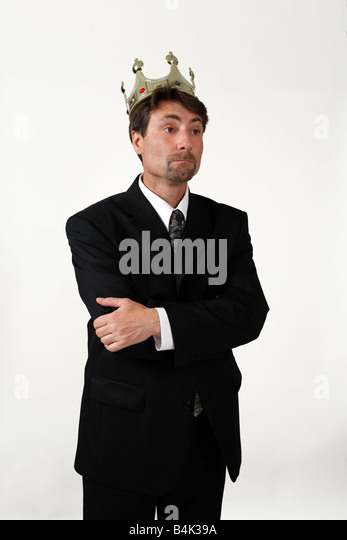 Male businessman 45 years old with crown on head - Stock Image
