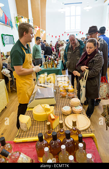 People at cheese stall at the Christmas Food Festival, Abergavenny, Wales, UK - Stock Image
