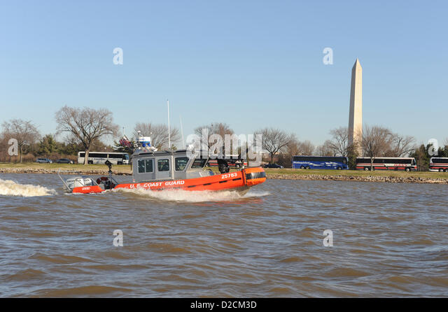 US Coast Guard Maritime Safety and Security Team pass the Washington Monument during a security patrol along the - Stock Image