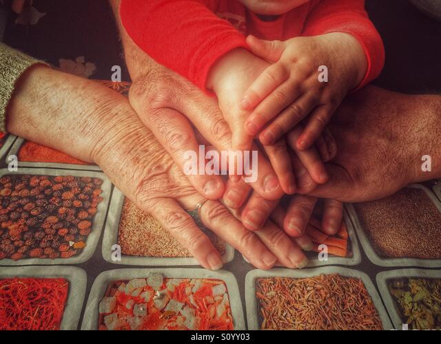 Three generations hands - Stock-Bilder