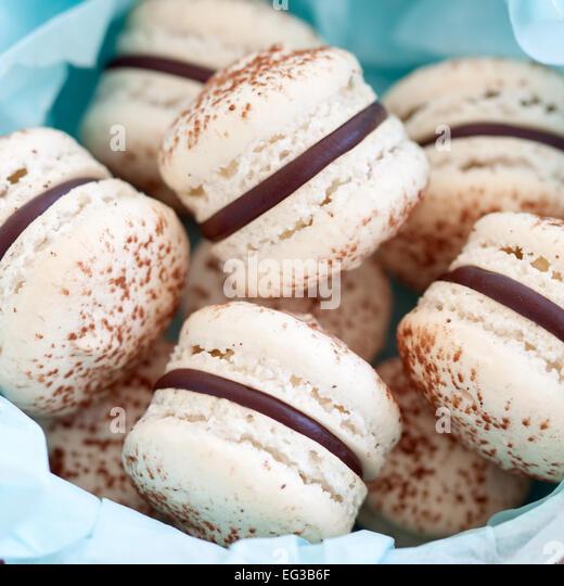 Gift box of chocolate macarons - Stock Image
