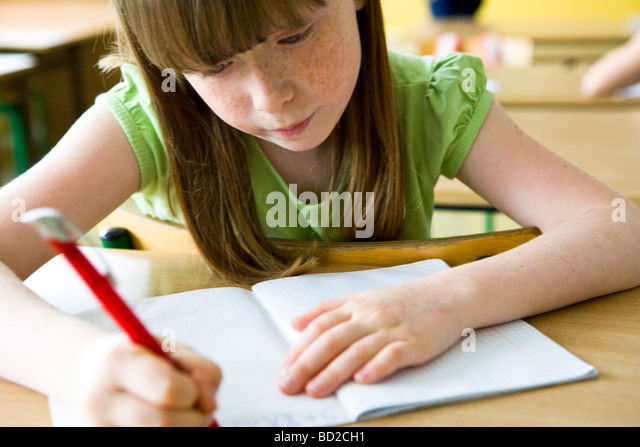 Girl studying at school - Stock Image