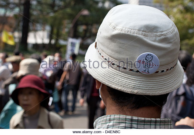 Tens of thousands of protesters march on the Japanese parliament to call for an end to nuclear power in Japan. - Stock Image