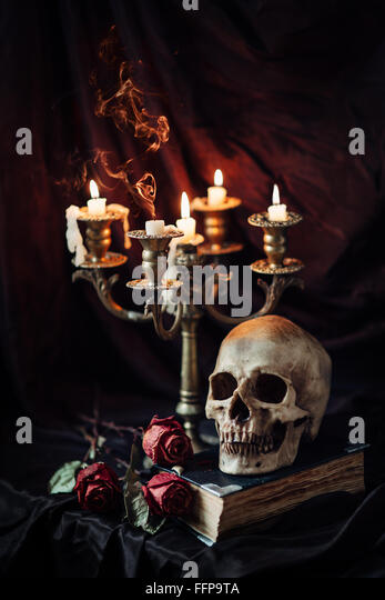 Still life with skull, book and candlestick - Stock-Bilder