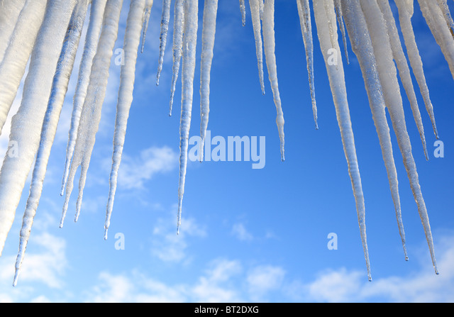 Icicles hanging against a blue sky - Stock-Bilder