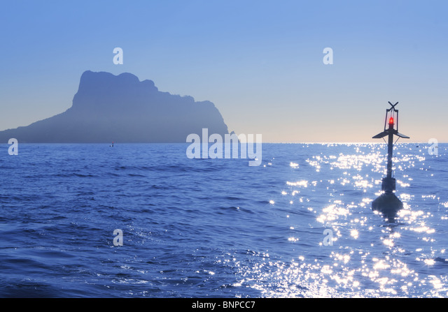 Ifach Penon mountain from Calpe fog backlight floating beacon - Stock Image