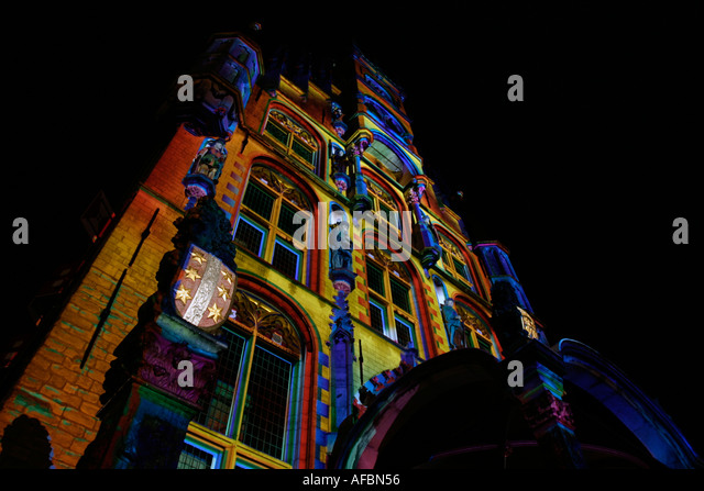 Town Hall in polychromatic light projection during Christmas in Gouda, Southern Holland, The Netherlands - Stock Image