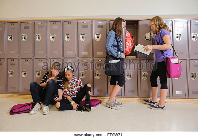 Students talking in school hallway - Stock-Bilder