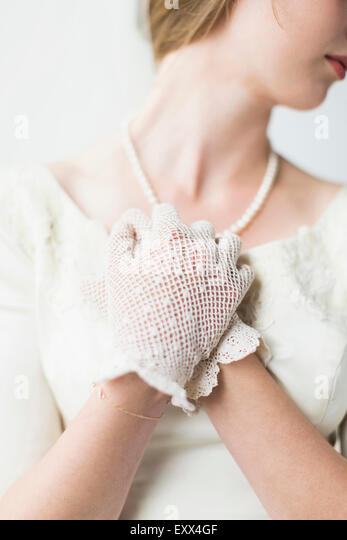 Mid section of bride wearing formal glove - Stock Image