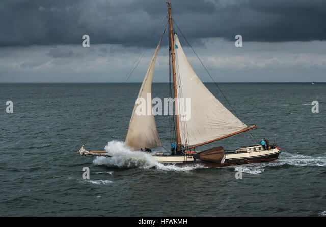 Wadden Sea Unesco World Heritage Site. Sailing on the Dutch Waddenzee on a traditional Tjalk sailing ship. Sailing - Stock Image