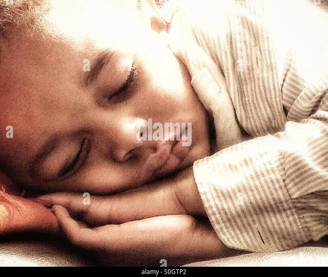 Sleeping child. - Stock Image