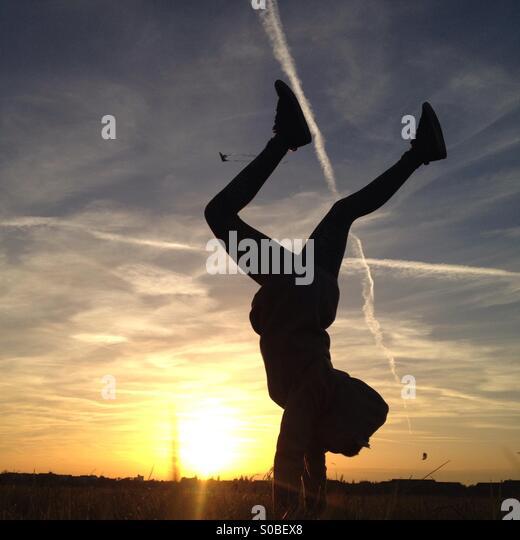 Handstand on Tempelhofer Feld - Stock Image