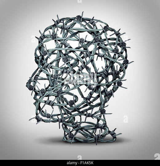 Tortured thinking and depression concept as a group of tangled barbwire or barbed wire fence shaped as a human head - Stock Image
