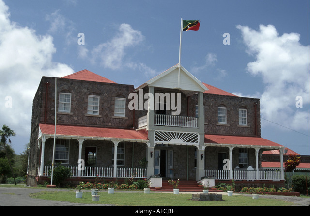 West Indies Nevis Charlestown Governor's House built 1909 St. Kitts and Nevis flag - Stock Image