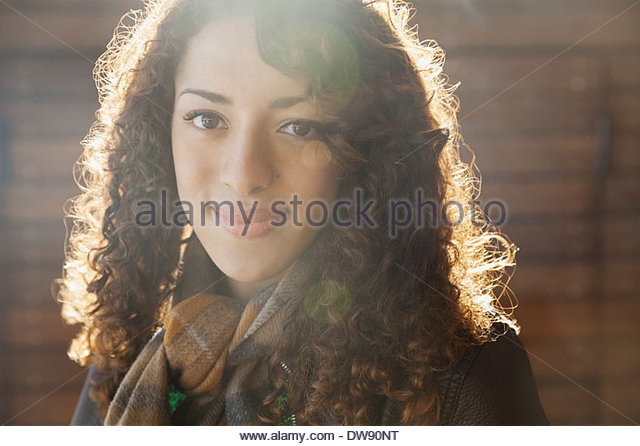 Close-up portrait of beautiful woman outdoors - Stock Image