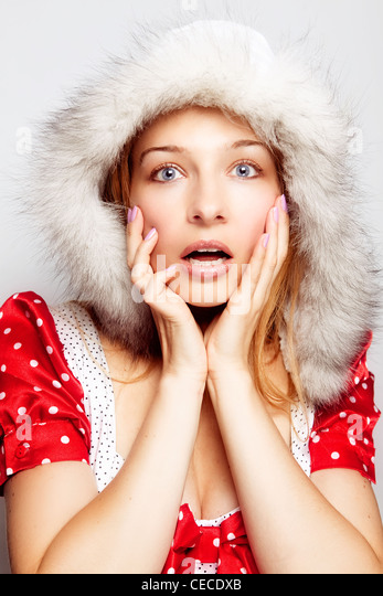 Winter surprise concept - cute amazed young woman - Stock-Bilder