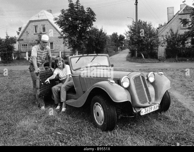 Vintage car owners proudly display their treasure - Stock Image