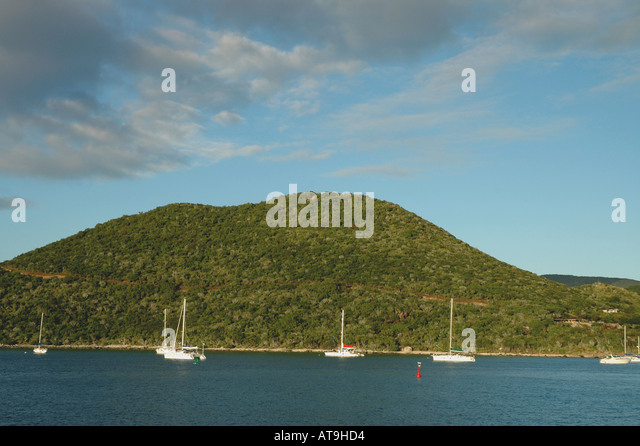 British Virgin Islands Virgin Gorda Sailing Cow Hill in background - Stock Image
