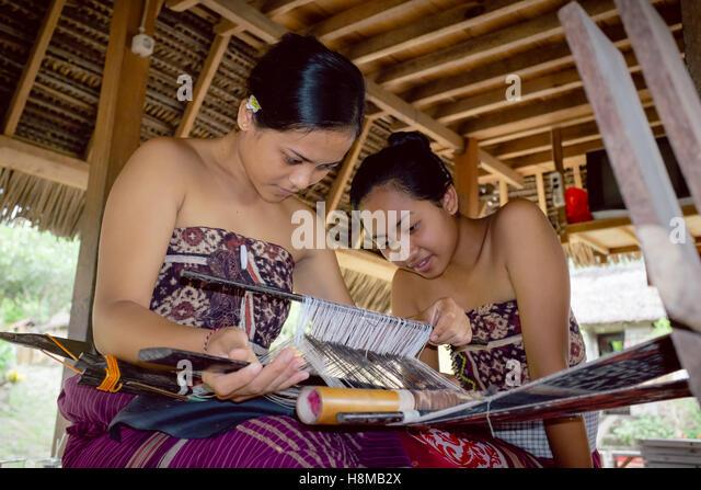 The Local Woman are making Batik in Tenganan Village - Stock Image