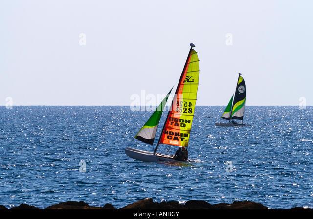 Hobie Cat catamaran off the shore at Alaminos Cyprus - Stock Image