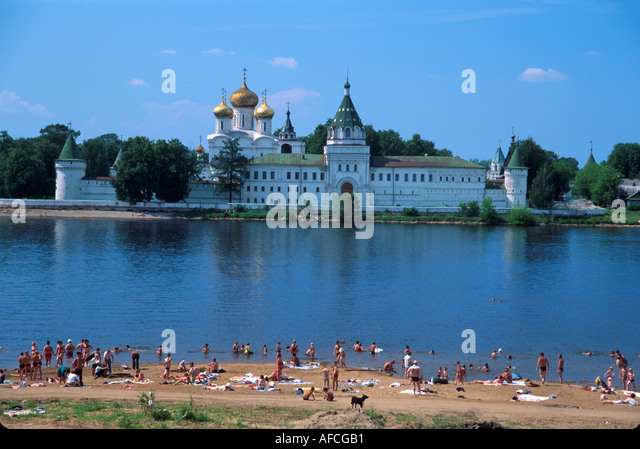 Russia former Soviet Union Kostroma Volga River resident swimmers Ipatyevsky Monastery beyond - Stock Image