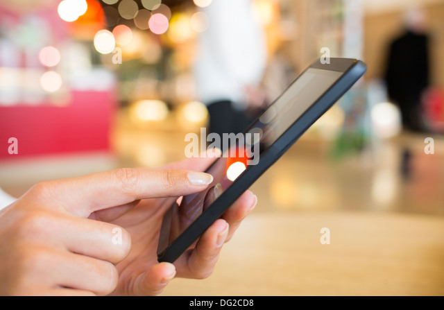 Female train mobile phone travel message sms - Stock Image